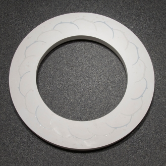 TJ Edwards circular ceramic and gypsum