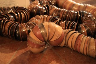 Thomas Lowell Edwards bowls nested in a line