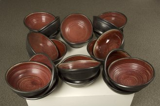 Thomas Edwards black bowls with red glaze